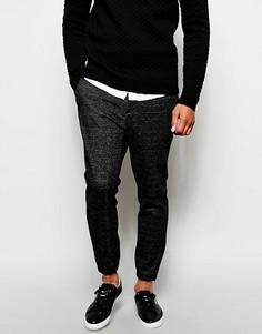 Элегантные зауженные спортивные брюки из первосортного трикотажа ASOS - Черный