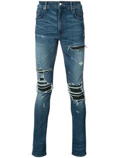 рваные джинсы кроя скинни Amiri