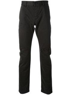 брюки-чинос с дырками на коленях Saint Laurent