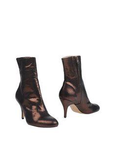 Полусапоги и высокие ботинки Nora