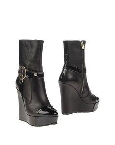 Полусапоги и высокие ботинки Galliano