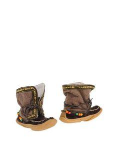 Полусапоги и высокие ботинки Yuketen