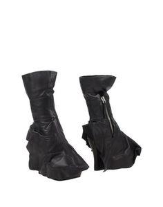 Полусапоги и высокие ботинки Camilla Skovgaard