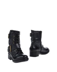 Полусапоги и высокие ботинки Sixt
