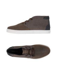 Высокие кеды и кроссовки Lacoste