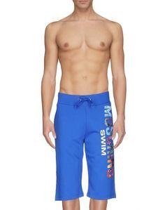 Пляжные брюки и шорты Moschino Swim