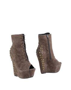 Полусапоги и высокие ботинки Rosario Cuomo