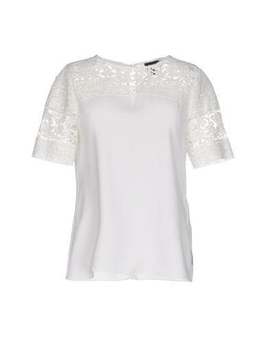 2e172f456e0 Белая блузка из эластичного шелка с завязками на бант от Dolce   Gabbana.  Рукава три четверти