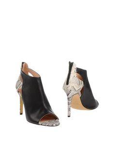 Полусапоги и высокие ботинки Andrea Catini