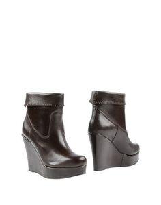Полусапоги и высокие ботинки Paolo Simonini