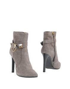 Полусапоги и высокие ботинки Andrea Morelli