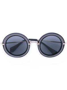 круглые солнцезащитные очки в массивной оправе Miu Miu Eyewear