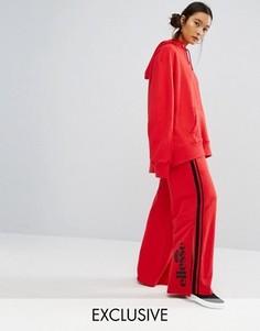 Широкие брюки с контрастной атласной полосой сбоку Ellesse - Красный