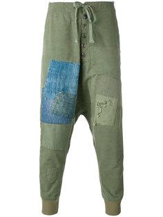 брюки с заниженной проймой и заплатками Greg Lauren
