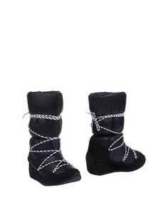 Полусапоги и высокие ботинки Lacoste