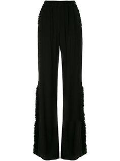 расклешенные брюки с необработанными краями Raquel Allegra