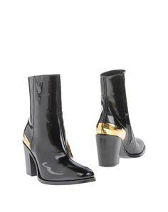 Полусапоги и высокие ботинки CÉline