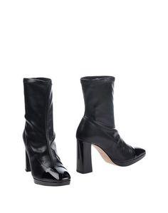 Полусапоги и высокие ботинки Farrutx