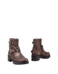 Полусапоги и высокие ботинки Kanna