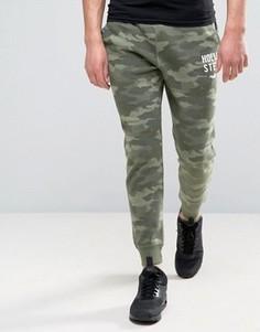 Зеленые джоггеры слим с камуфляжным принтом Hollister - Зеленый
