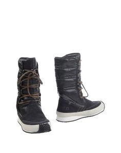 Полусапоги и высокие ботинки Tretorn