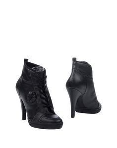 Полусапоги и высокие ботинки Guess