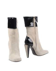 Полусапоги и высокие ботинки Studio Pollini