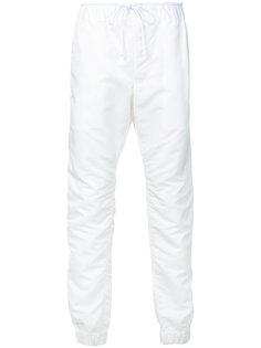 зауженные брюки на шнурке Sacai