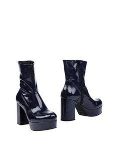 Полусапоги и высокие ботинки Zinda