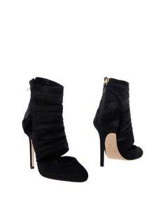 Полусапоги и высокие ботинки Genny