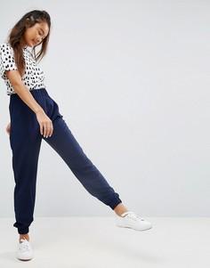 Креповые суженные книзу брюки с манжетами ASOS - Темно-синий