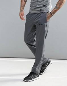 Серые спортивные брюки из ткани Dri-FIT от Nike 800201-021 - Серый