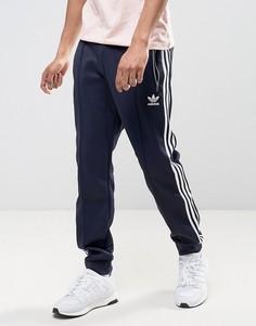 Синие джоггеры с манжетами adidas Originals London Pack BK7877 - Синий