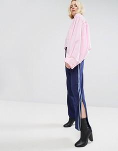 Широкие спортивные брюки с полосой сбоку и молнией на щиколотке STYLENANDA - Темно-синий
