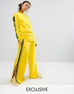 Широкие брюки с контрастной атласной полосой сбоку Ellesse - Желтый
