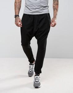 Легкие джоггеры с заниженным шаговым швом и карманами на молнии ASOS - Черный