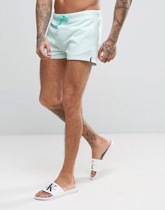 Короткие шорты для плавания из жатой ткани в полоску ASOS - Зеленый