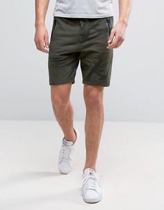 Эластичные спортивные шорты оливкового цвета с камуфляжным принтом Abercrombie & Fitch - Зеленый