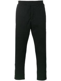 зауженные брюки с декоративными молниями Alexander McQueen