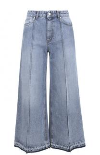 Укороченные расклешенные джинсы с потертостями Alexander McQueen