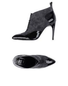 Полусапоги и высокие ботинки Roger Vivier