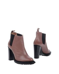 Полусапоги и высокие ботинки Pollini