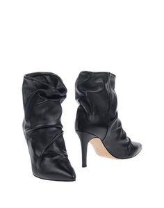 Полусапоги и высокие ботинки Carla G.