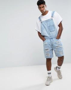 Светлый рваный джинсовый комбинезон New Look - Синий