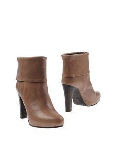 Полусапоги и высокие ботинки Nadia C.