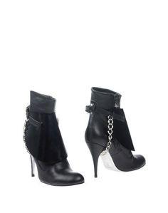 Полусапоги и высокие ботинки Vivienne Westwood