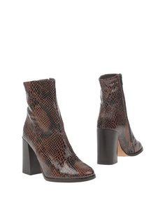 Полусапоги и высокие ботинки Gusto