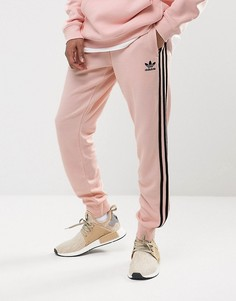 Розовые джоггеры с манжетами adidas Originals Superstar BS4656 - Розовый