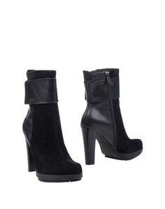 Полусапоги и высокие ботинки Calvin Klein