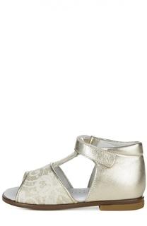 Сандалии из металлизированной кожи с ажурным декором Clarys